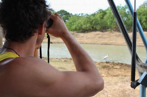 Chris looking through binoculars at Yala