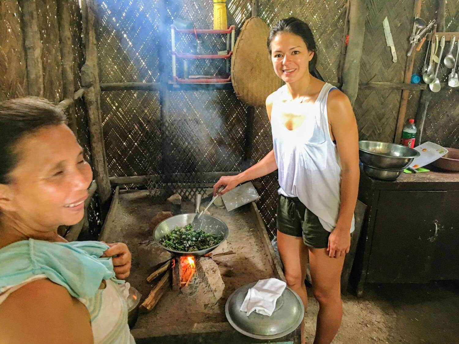 Kim cooking in a rustic hut in Palawan
