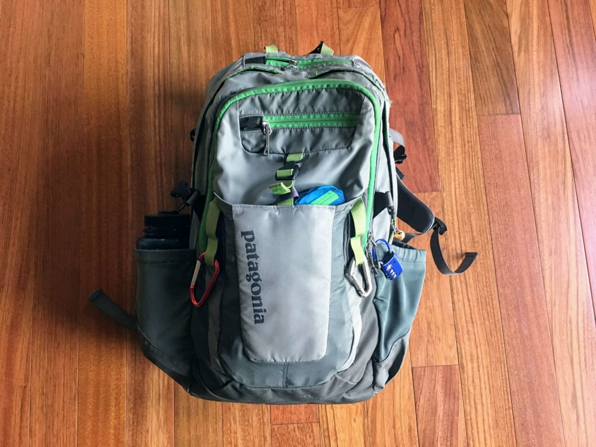 Chris' backpack filled with the items in his minimalist packing list for men.