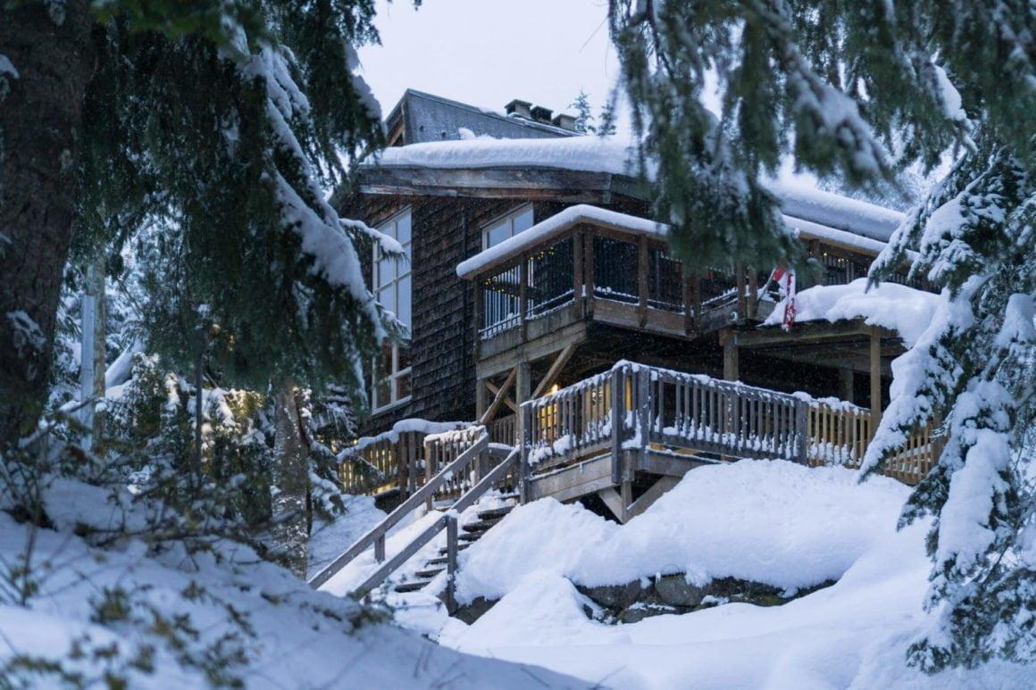 whistler lodge hostel exterior in winter