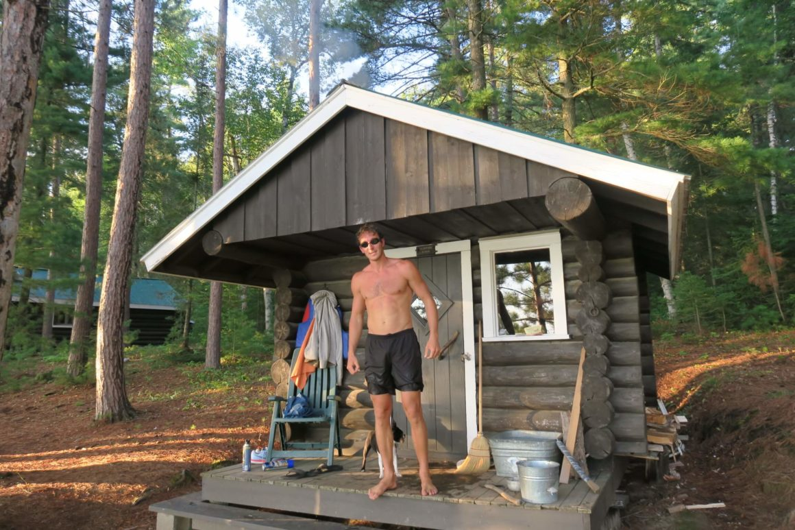chris wearing goggles in front of sauna