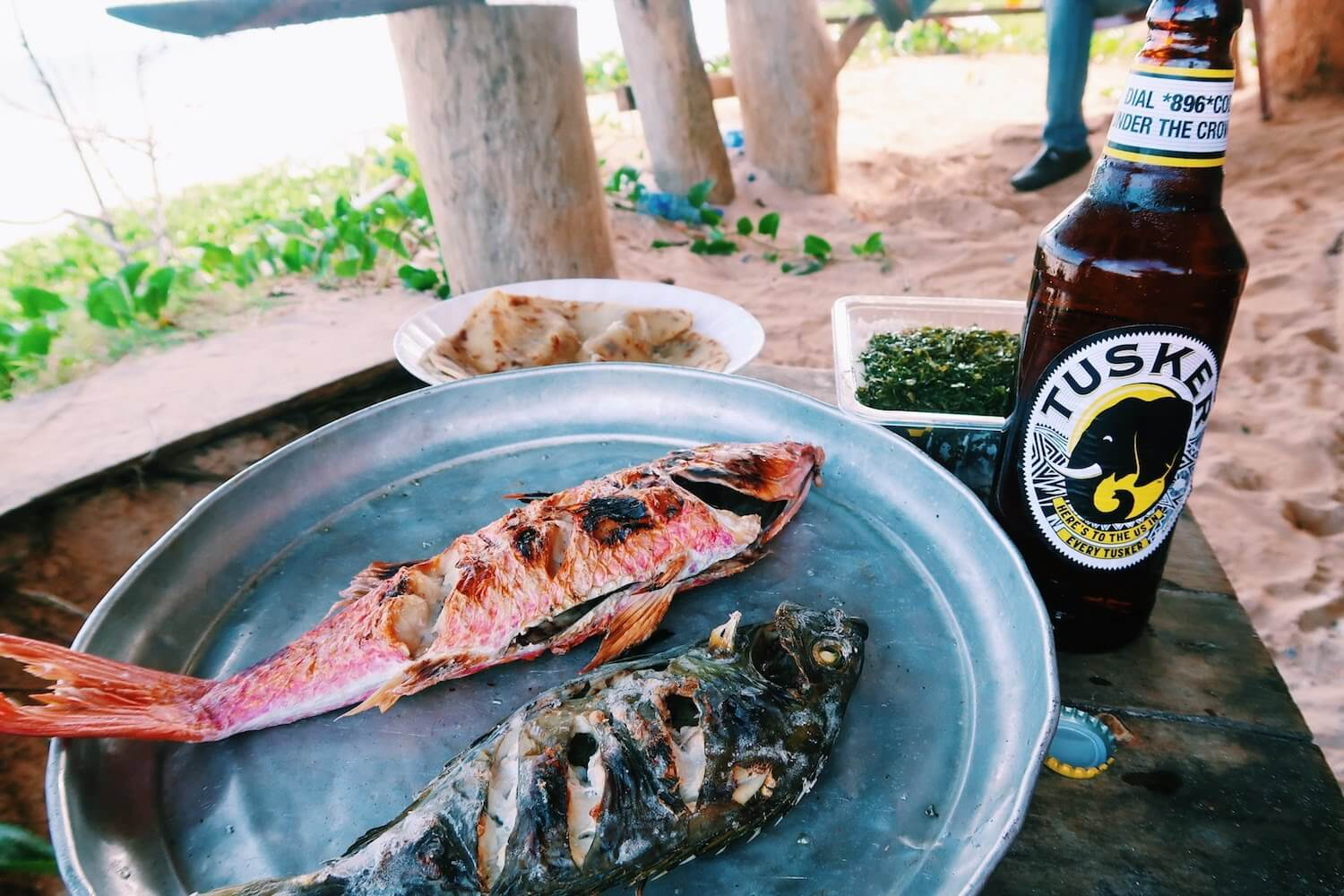 fish and beer on the Kilifi beach