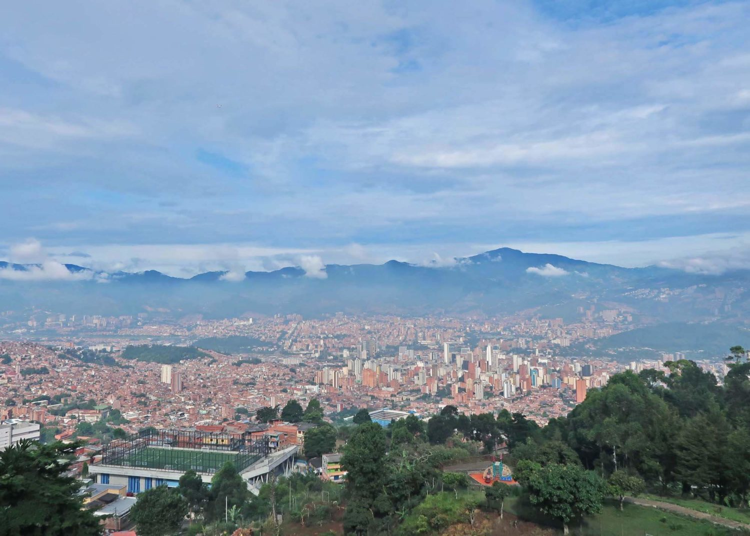 Medellin travel blog cover image of the city seen from Pan de Azucar