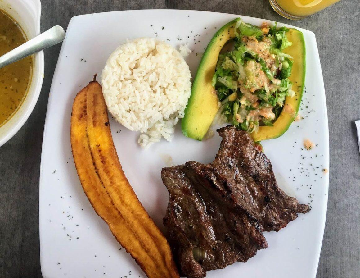 Looking down at basic meat, salad, rice, menu del dia from Aguacate Arbol