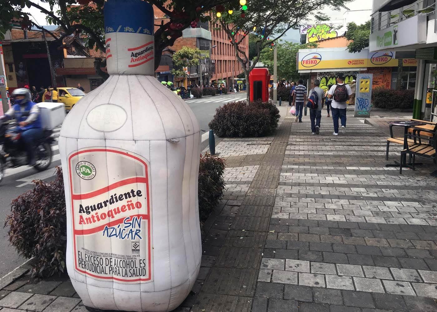 Inflatable bottle of aguardiente on Medellin sidewalk
