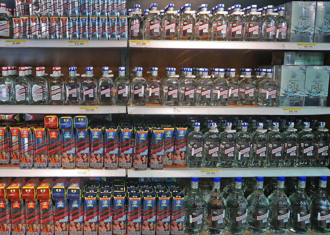 Supermarket shelf full of aguardiente