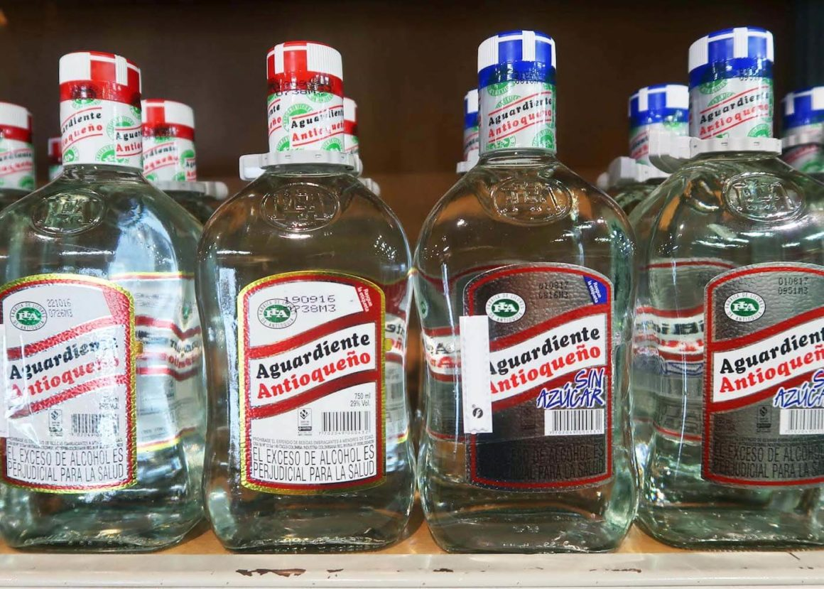 Side by side of red and blue cap aguardiente Antioqueño