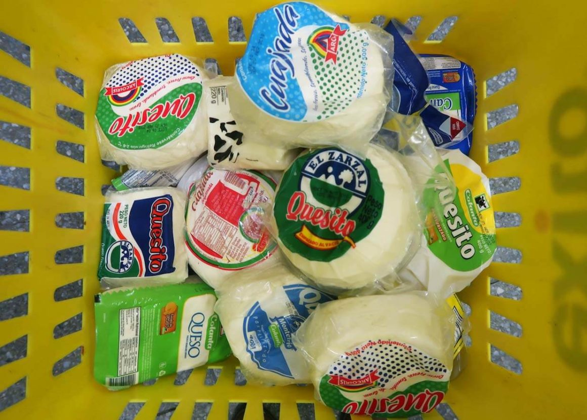 Supermarket basket full of Colombian cheeses
