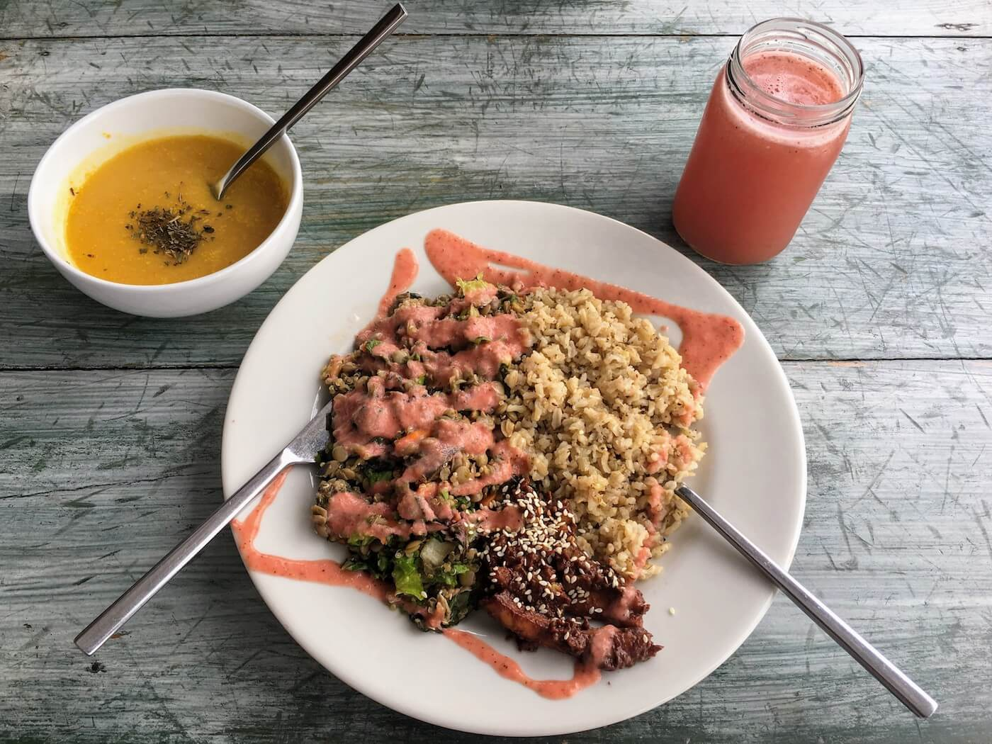 Dharma Vegan Restaurant's soup, menu del dia, and juice pictured from above