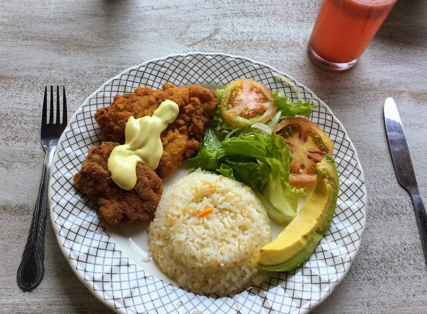 Flor fried fish, rice, avocado, and salad
