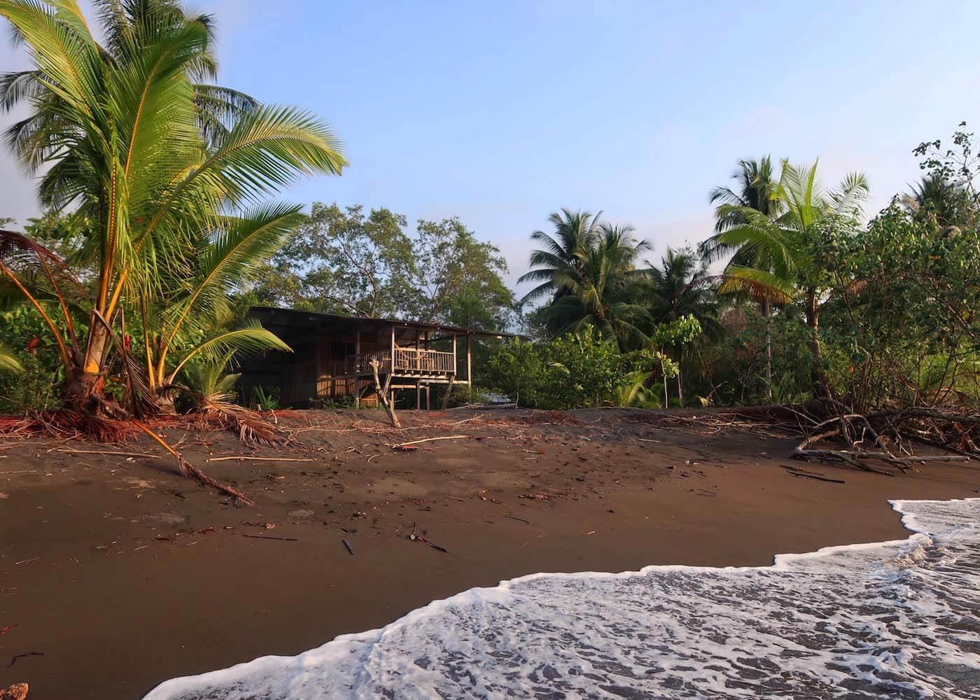 Beach hut and Pacific shore by Bahia Solano