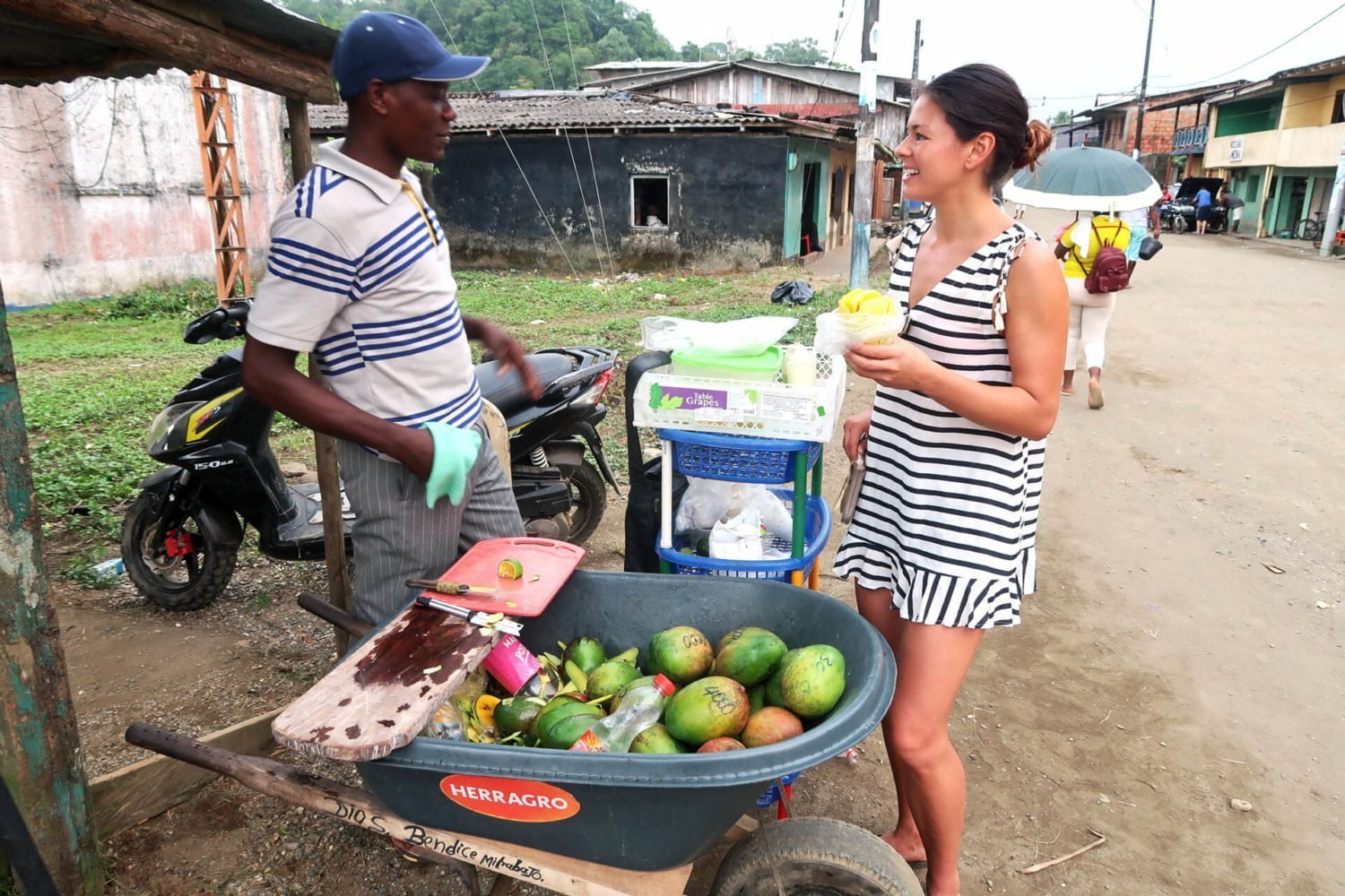 kim buying mango in el valle town bahia solano on colombia's pacific coast