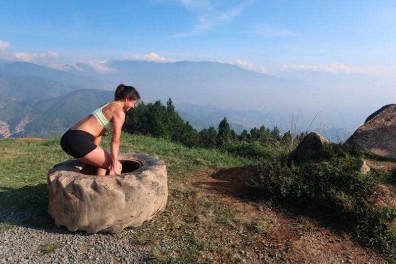 kim deadlifting a tire at the top of cerro las tres cruces medellin colombia