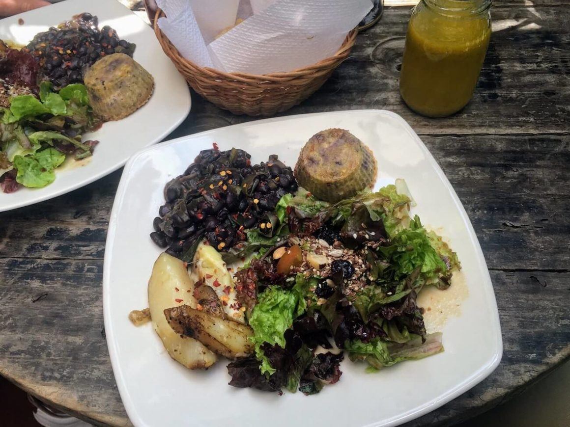 Naturalia lunch menu plate of potatoes, muffin, salad, and beans