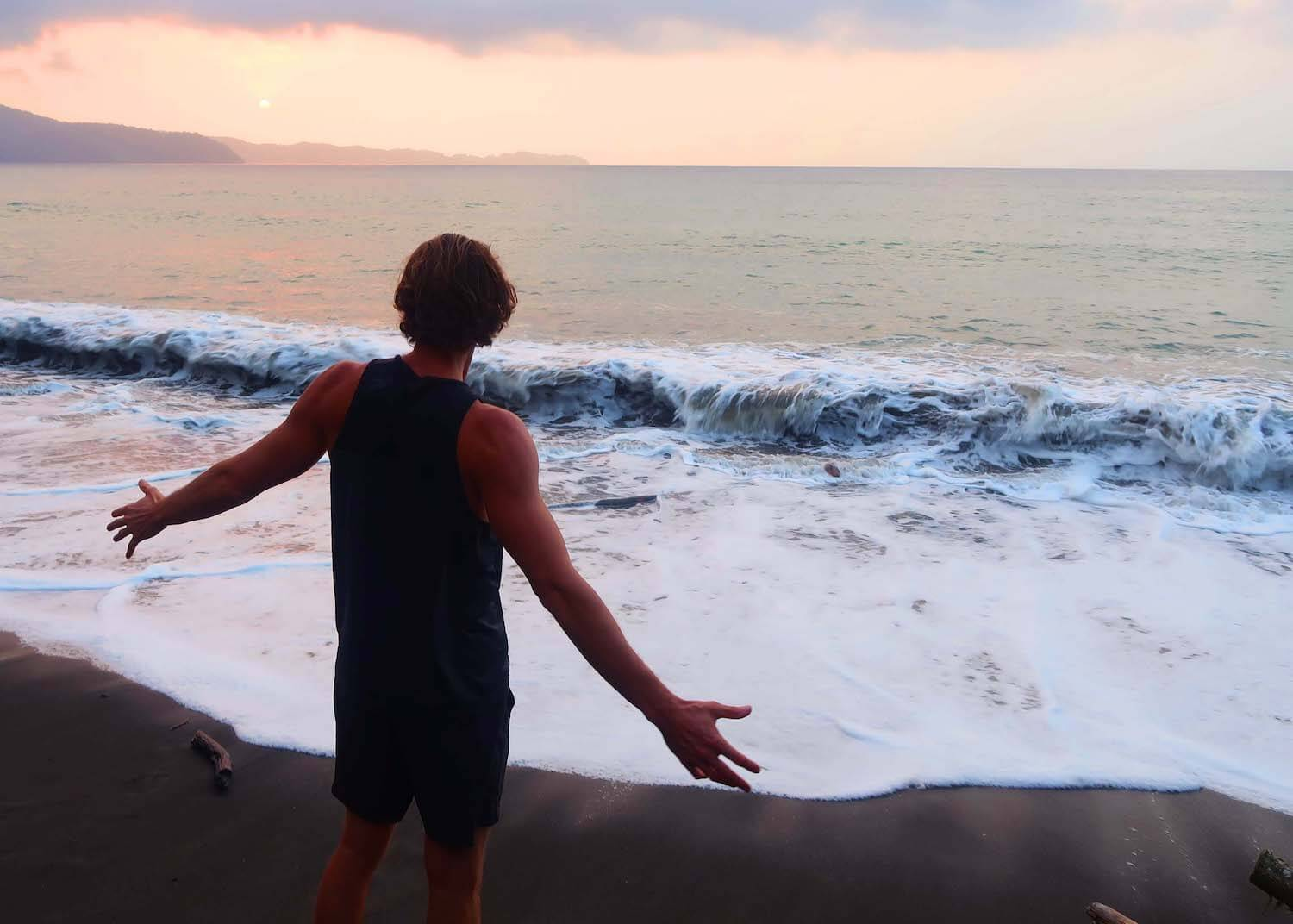 Chris embracing the solitude of Playa Mecana on Colombia's Pacific Coast