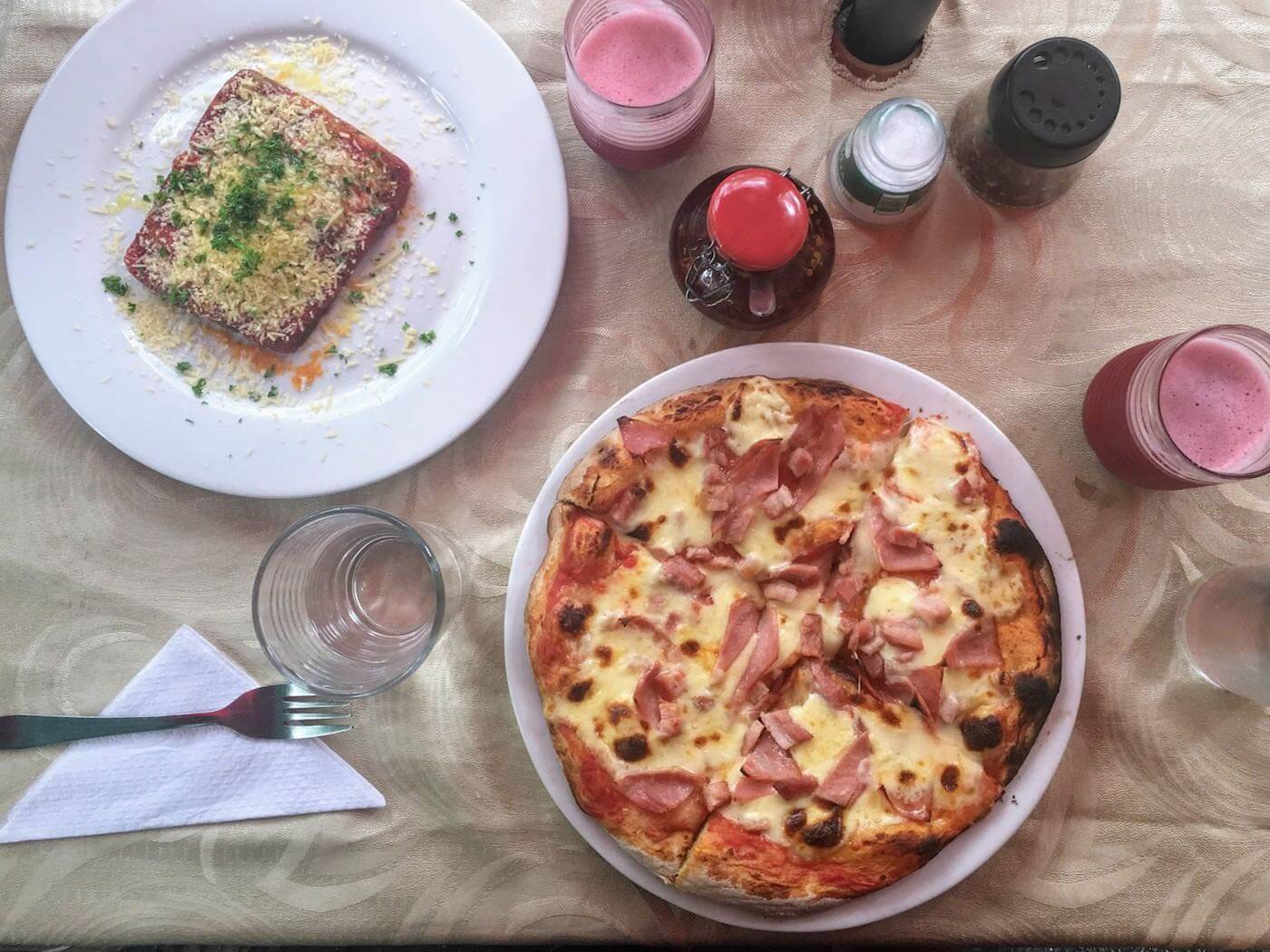Looking down on our pizza and lasagna from Toscano