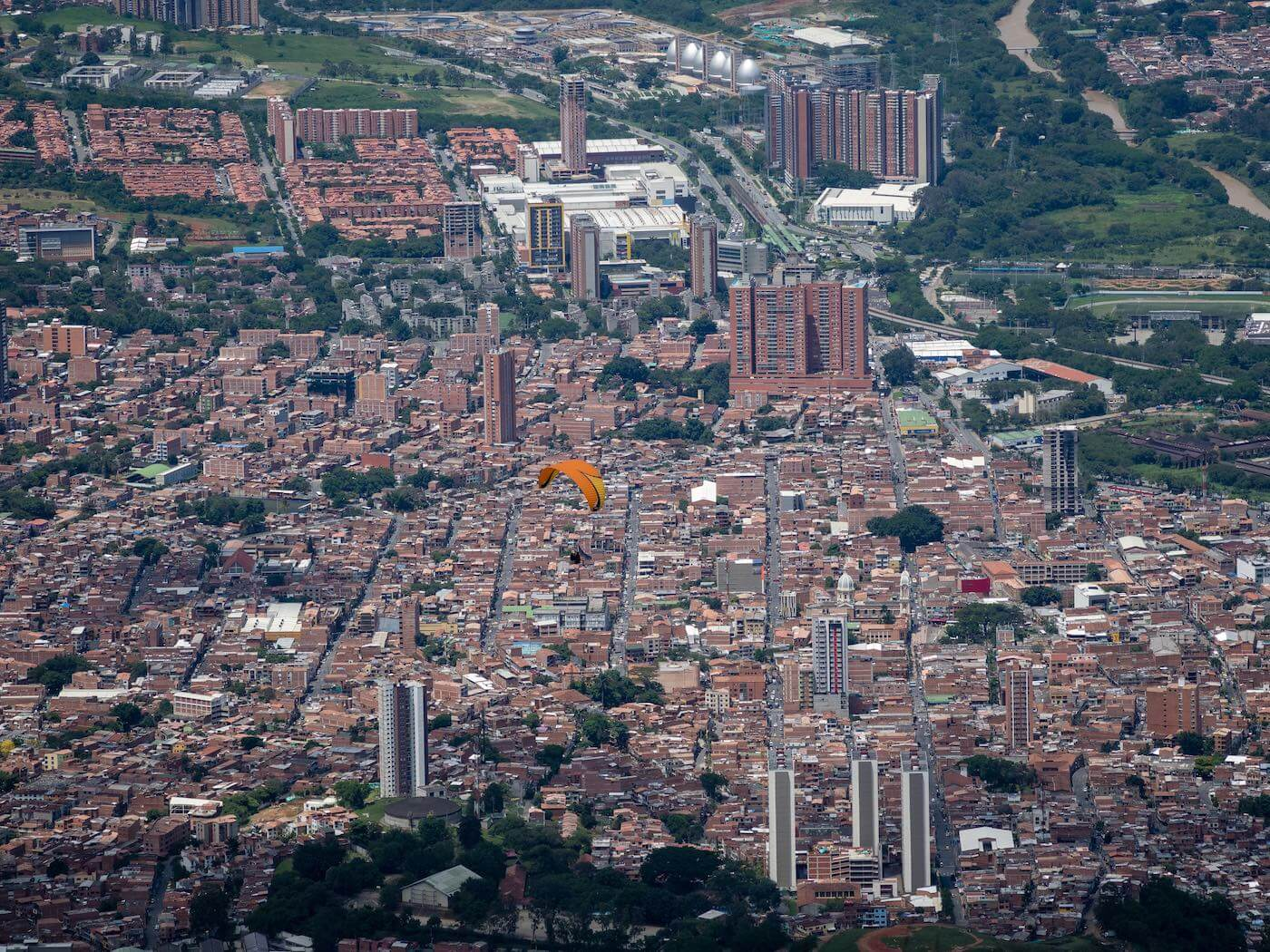 My paraglider with the city of Medellin below