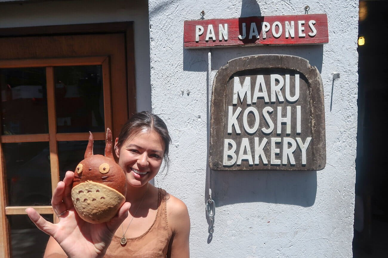 Kim showing off a pastry at Marukoshi bakery by Coyoacan