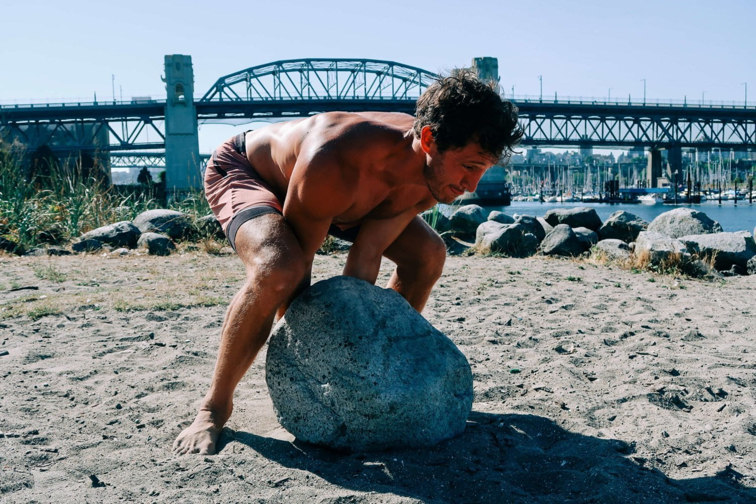 Chris rolling boulder at Sunset Beach in Vancouver.