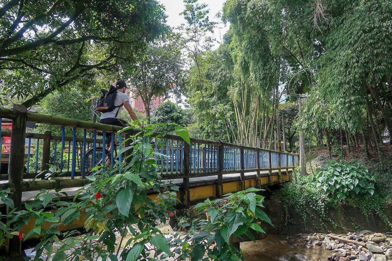 Biking over bridge in El Poblado, Medellin