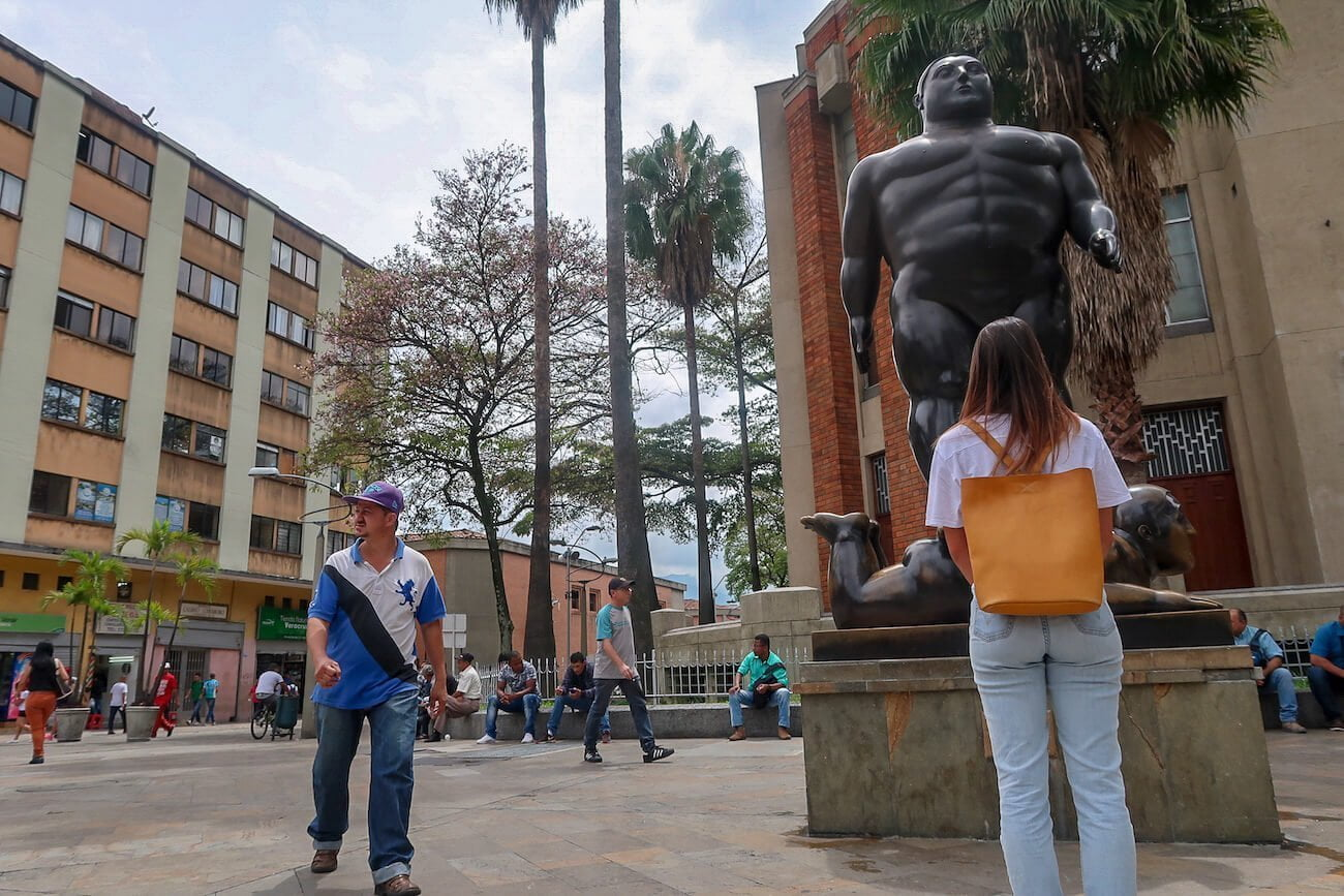 Kim standing in Plaza Botero in Downtown Medellin.