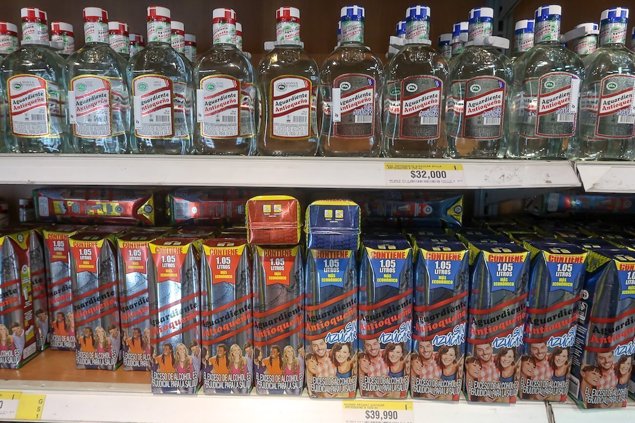 Aguardiente shelf at Exito in Medellin.