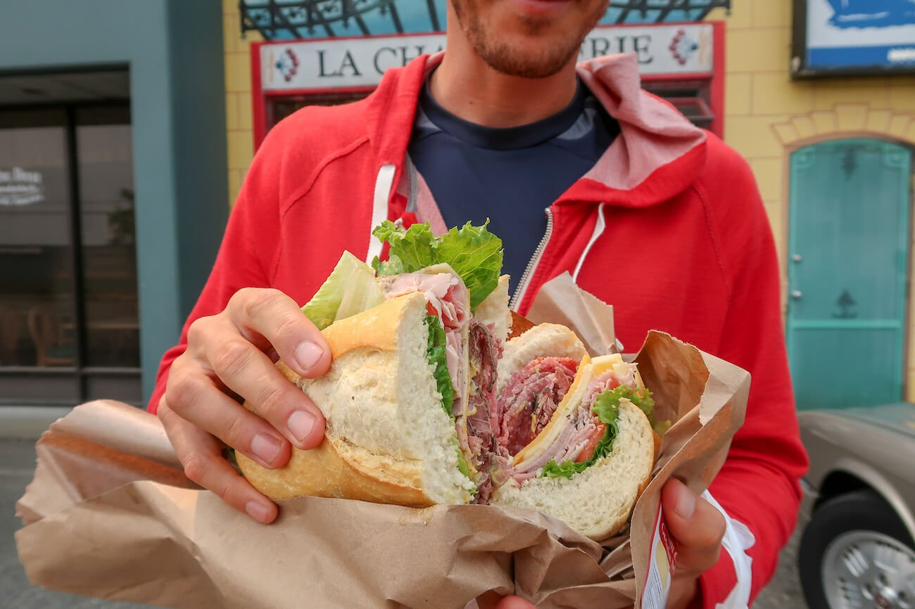 only in Vancouver dining experience close up of la charcuterie sandwich cover photo