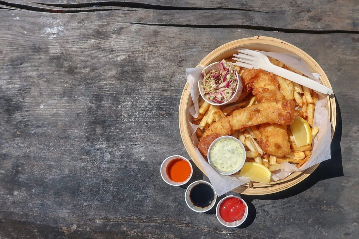 Fish and chips on picnic table from above