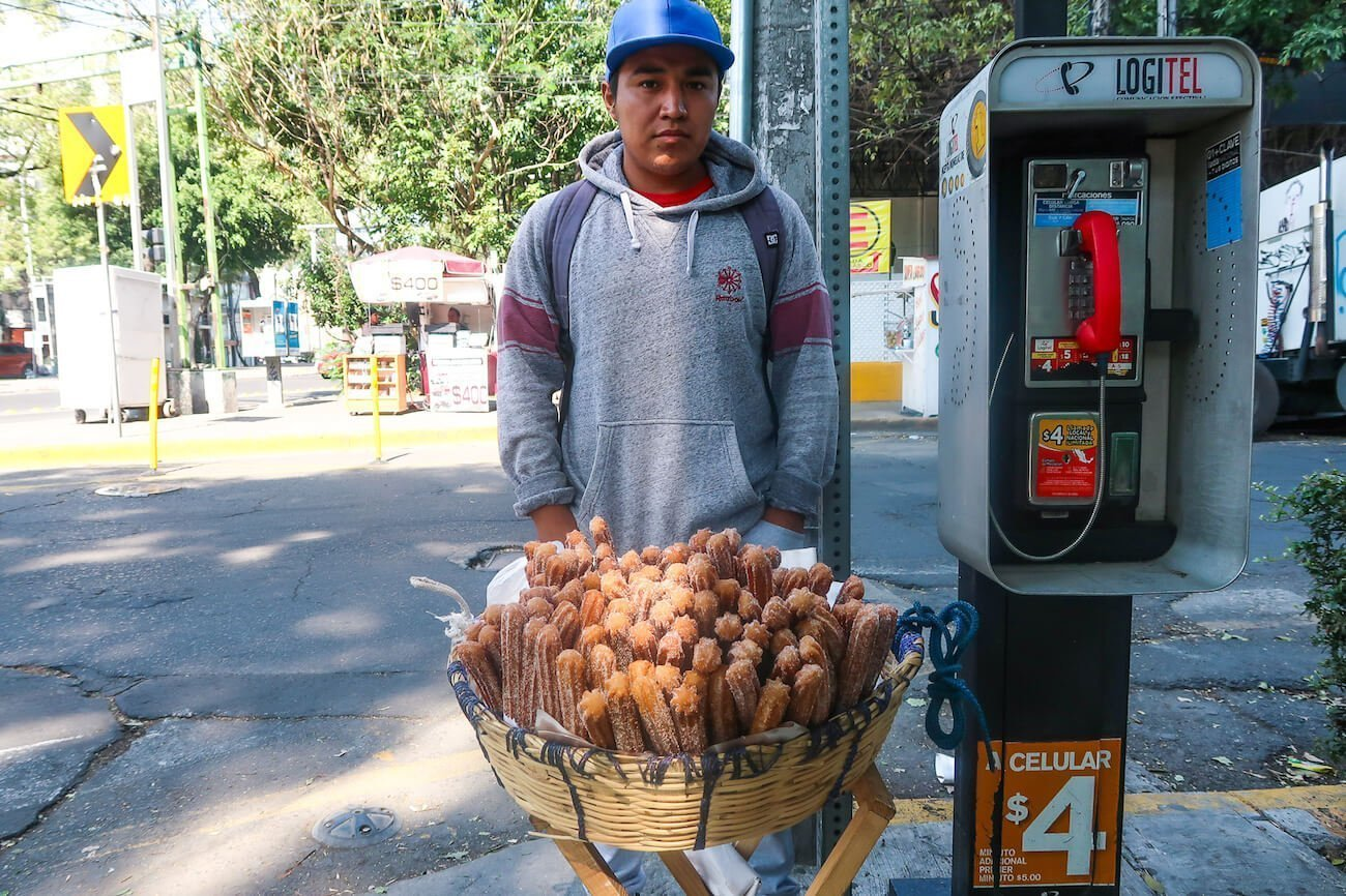 Vendor and his basket of churros on a Mexico City street