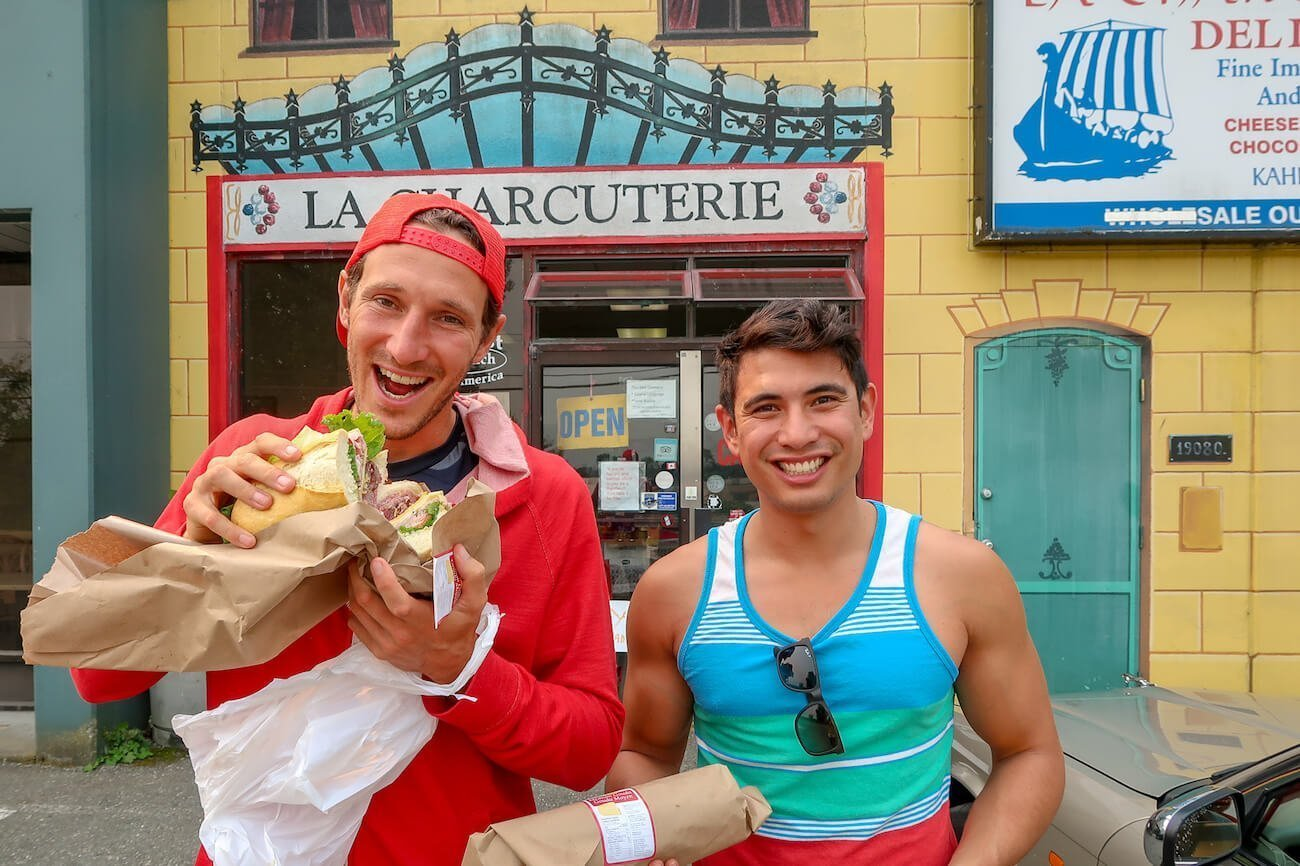 Eating sandwiches in front of la Charcuterie