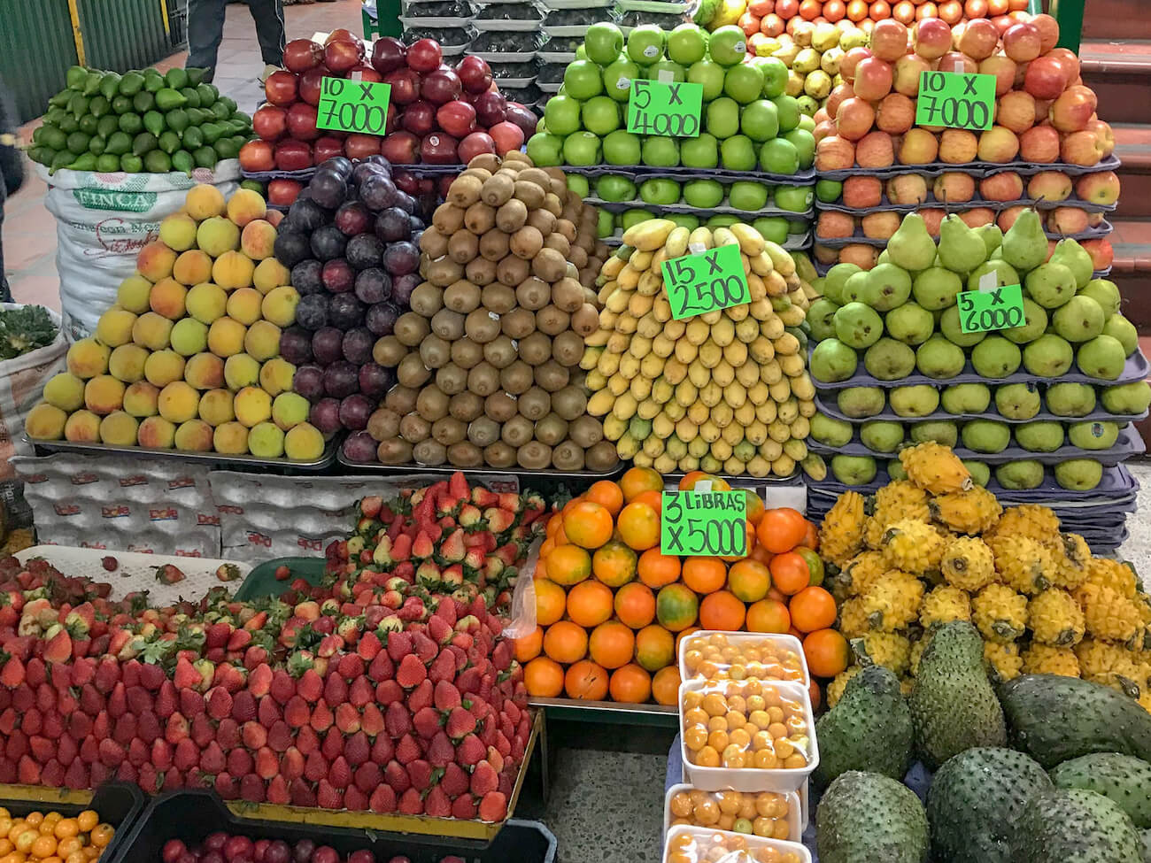stacks of fruit at Mercado Minorista, an underrated Medellin attraction