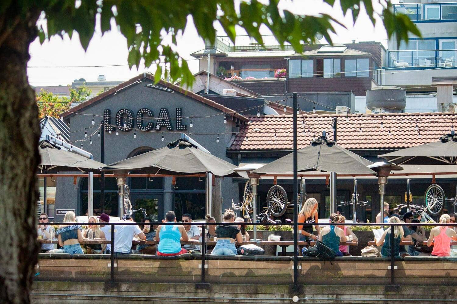 View of people have food and drinks at The Local in Kitsilano