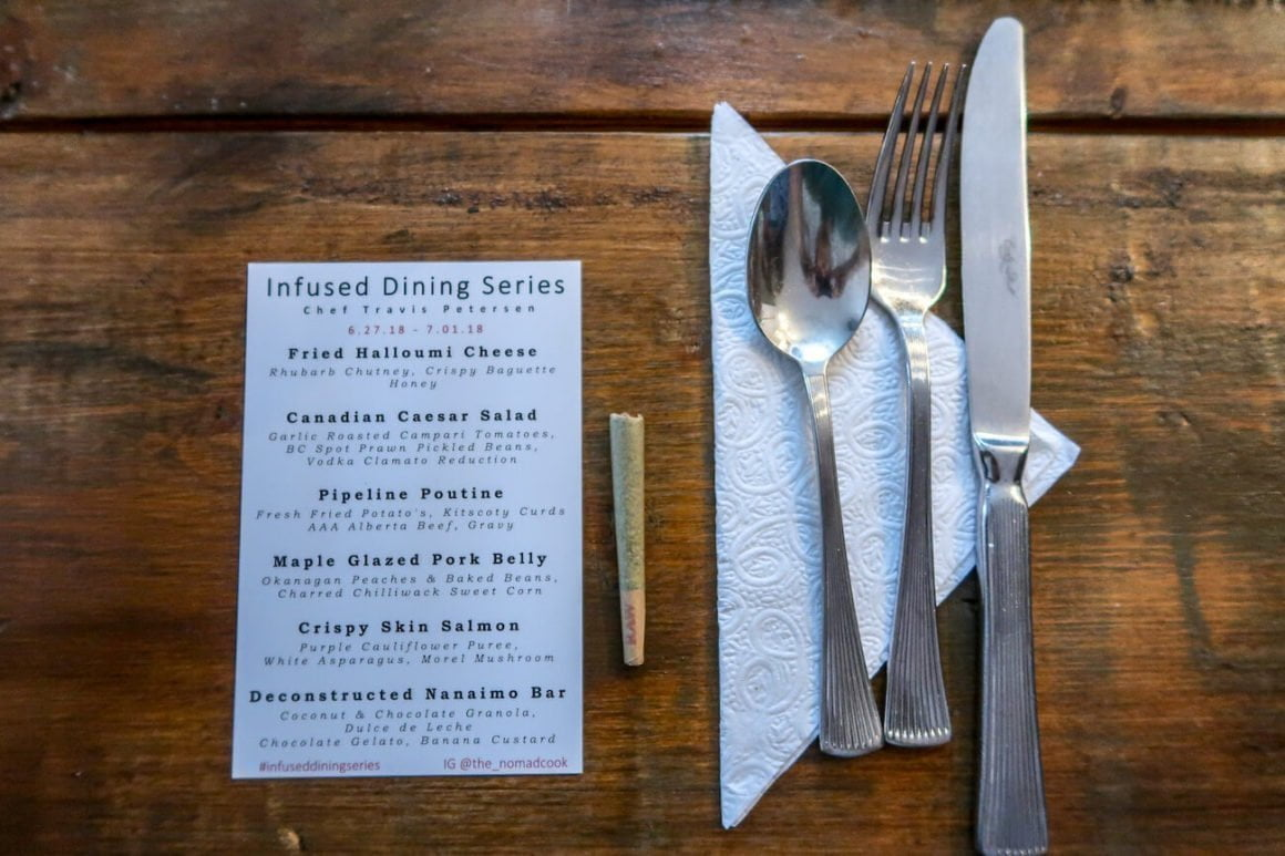 Menu, cutlery, and a joint on the table at The Nomad Chef's Infused Dining Series
