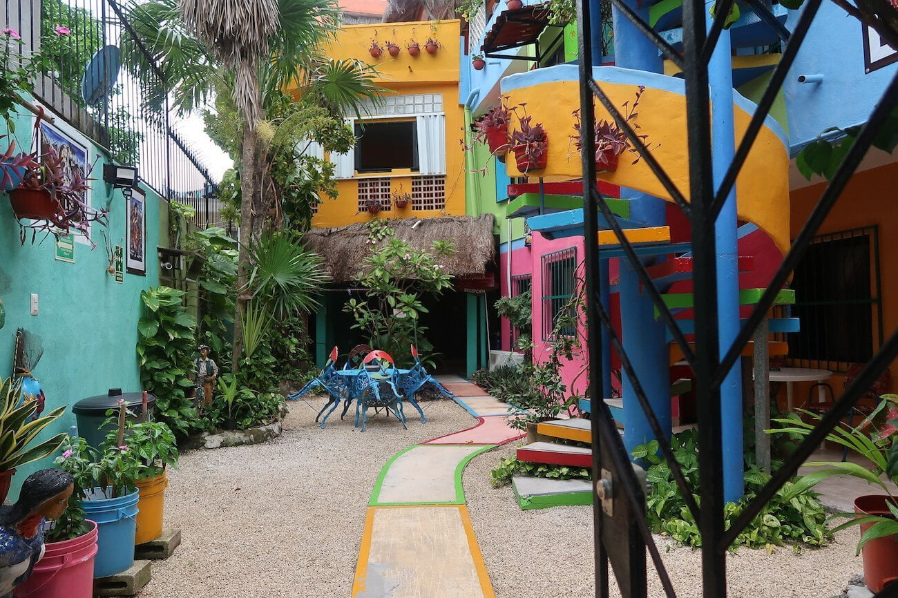 The courtyard of Hotel Colorado, and ideal spot for people backpacking in Playa del Carmen and looking for a quiet, comfortable hotel.