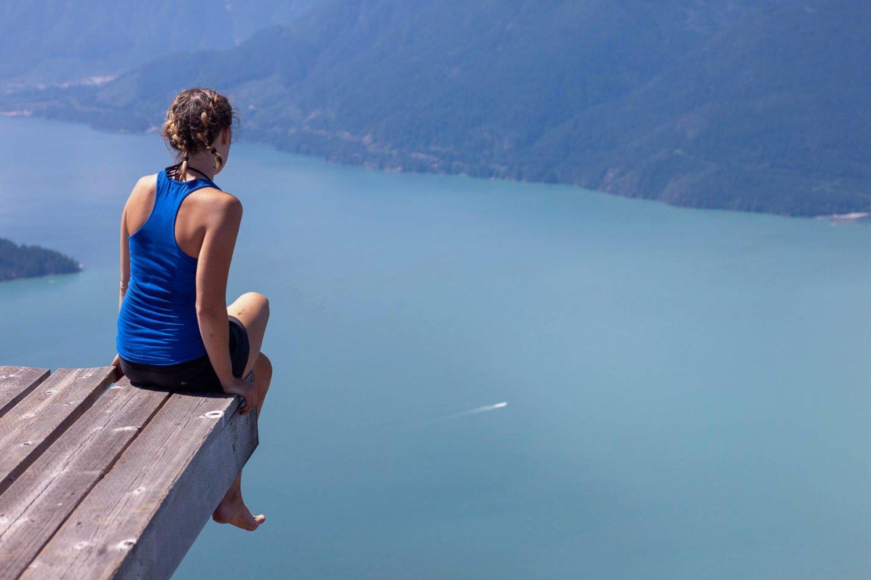 rebecca sitting on edge of heli pad anvil island