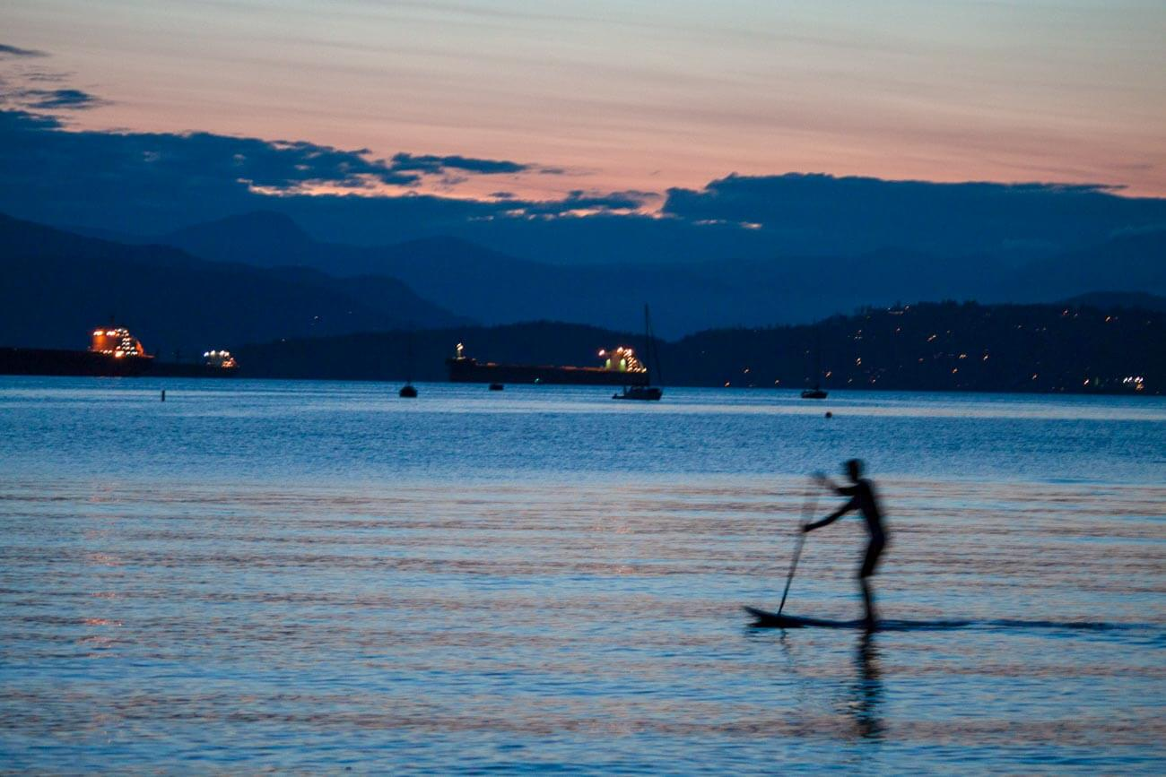 Guy SUPing at twilight