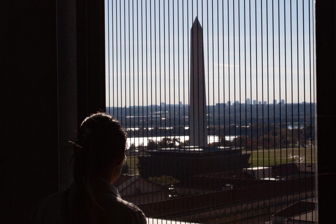 Kim looking at the Washington Monument from the Old Post Office tower.