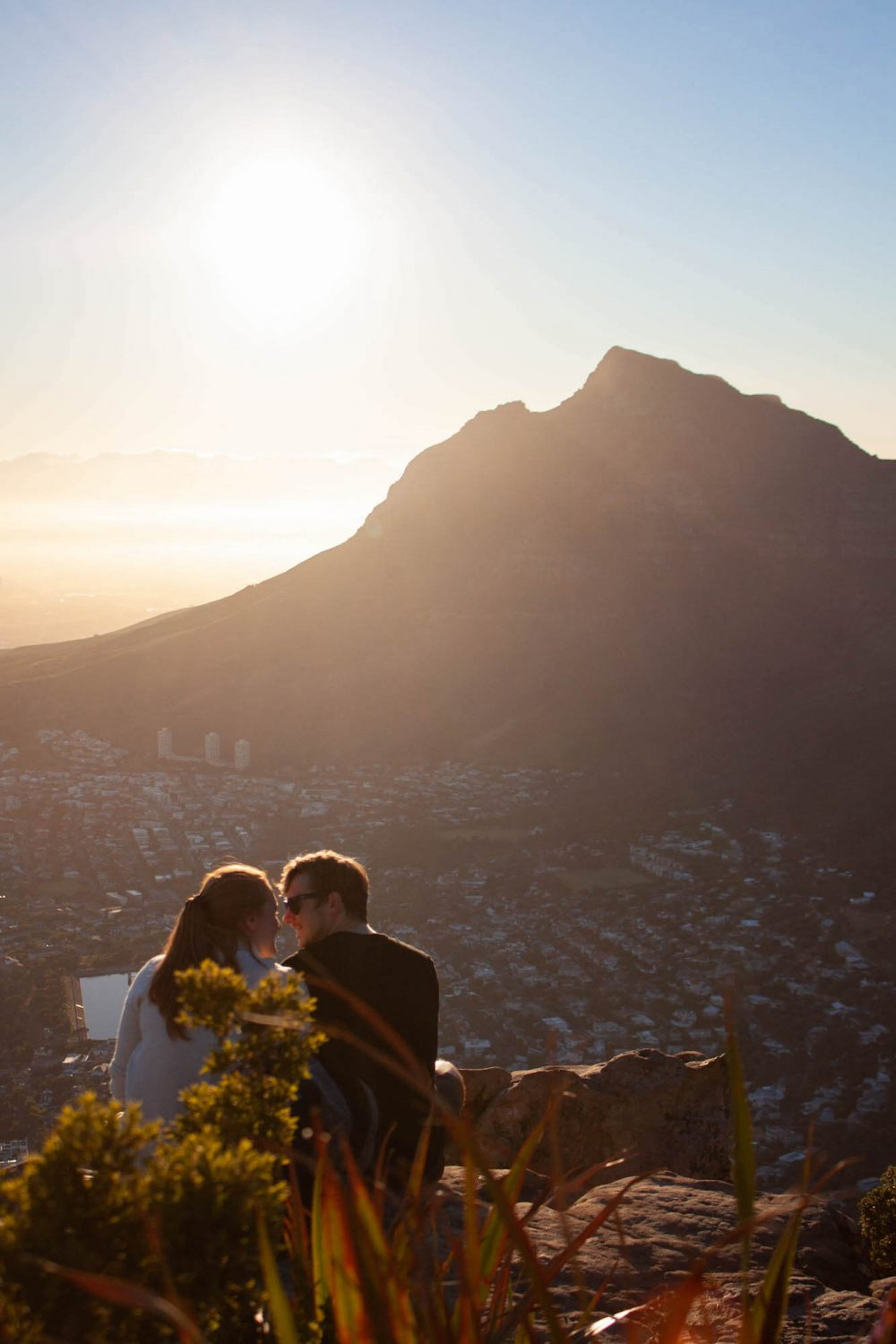 Couple atop Lion's Head at sunrise