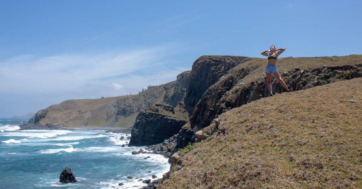 Kim posing on scenic Mdumbi to Coffee Bay hike