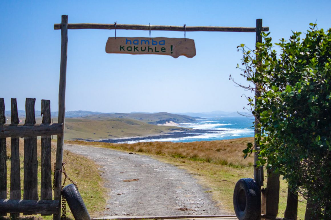 South Africa Road Trip Planning tips cover image of a sign saying bon voyage in xhosa