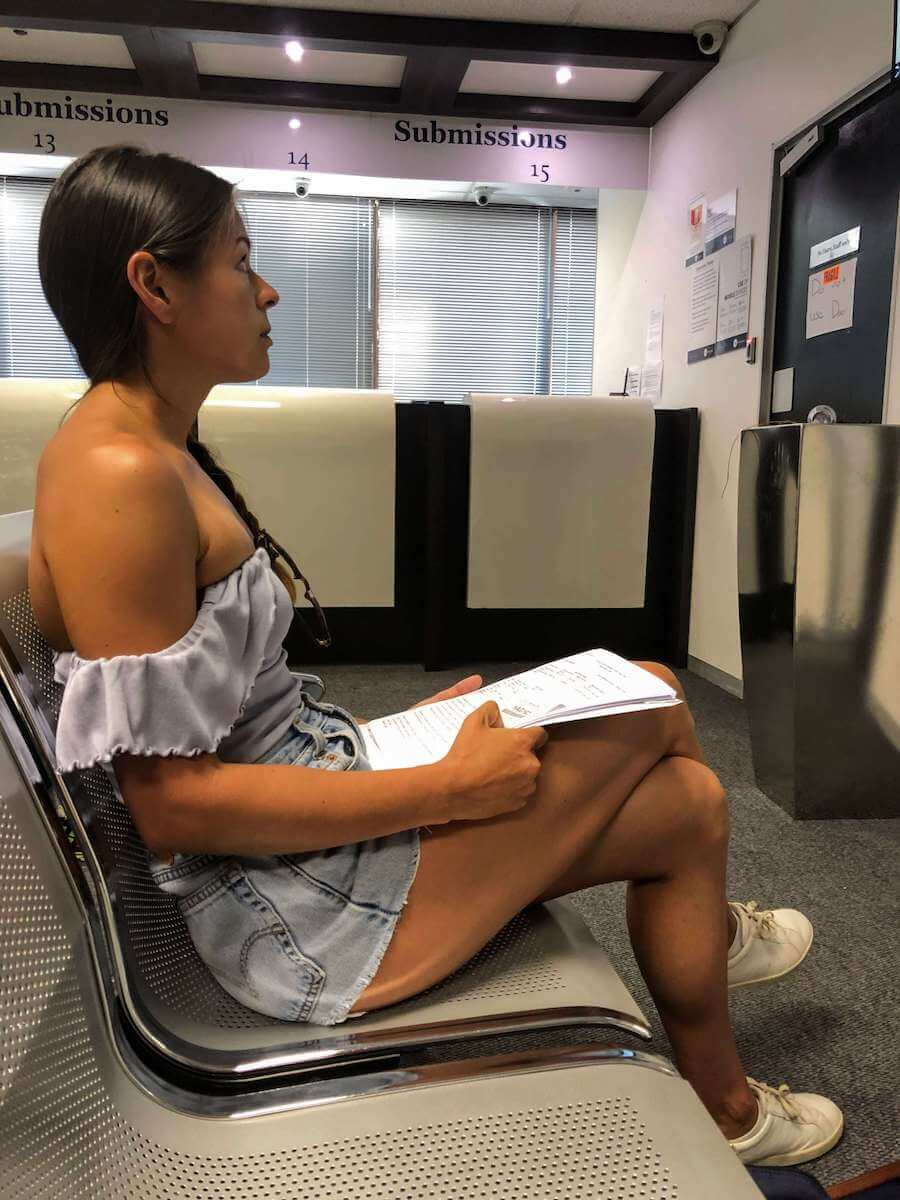 Kim waiting to submit her application to extend her South African travel visa