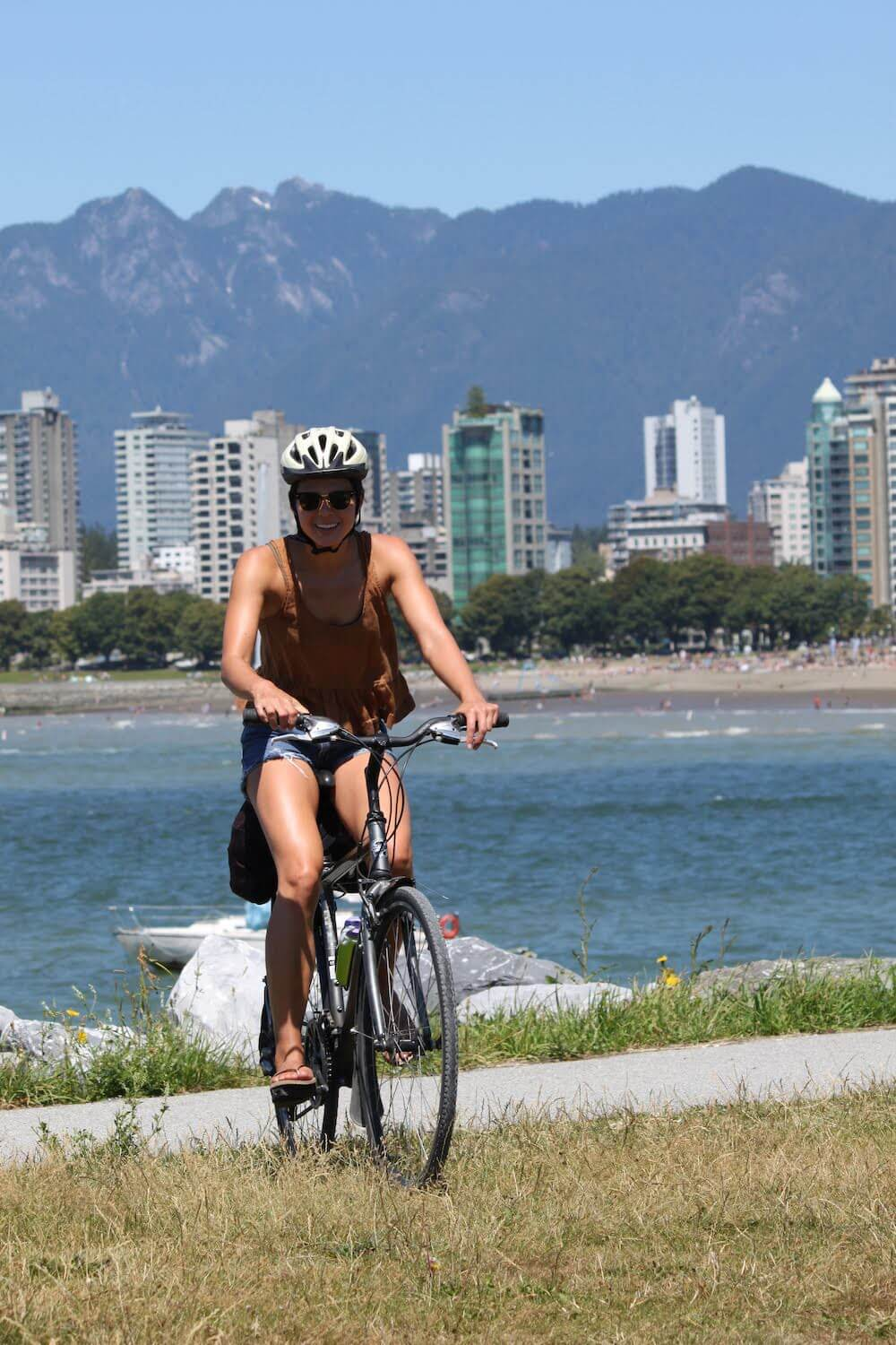 Kim on a bike in Kits.