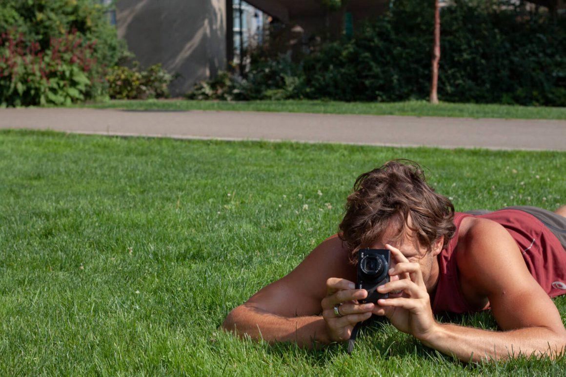 Chris taking photos on grass