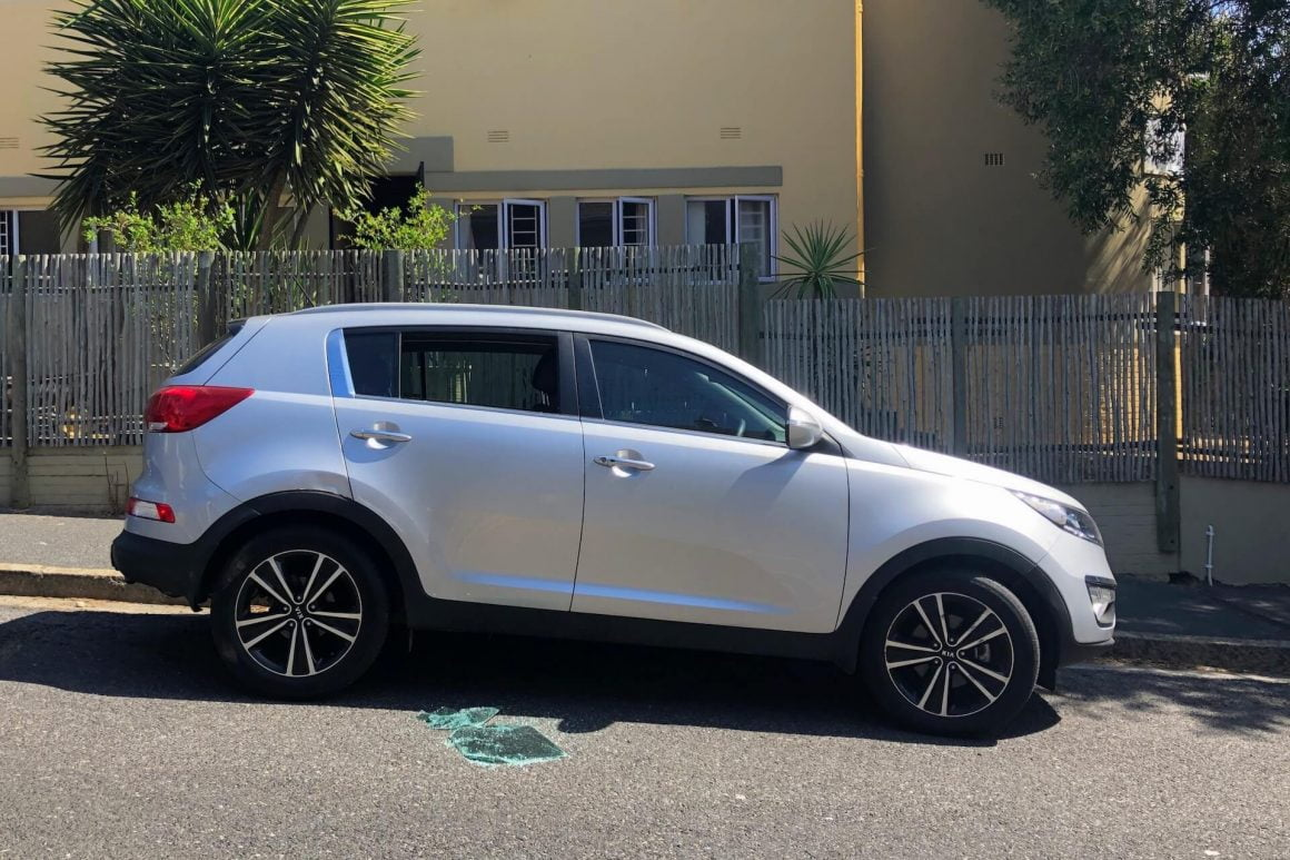 Car parked on a Cape Town street with a smashed-in window.