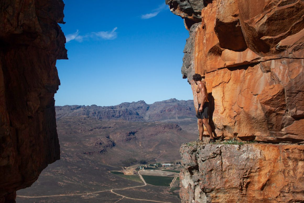 Chris peers over the ledge on our hike to Wolfberg Cracks in Cederberg.