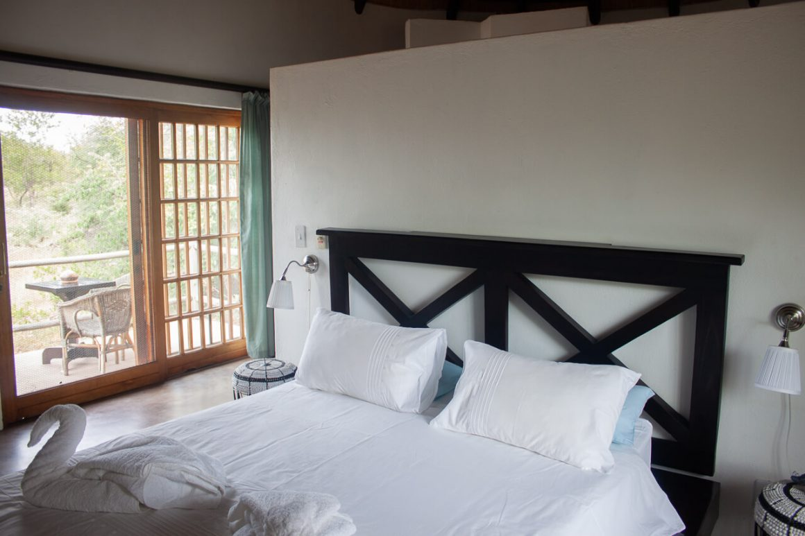 Bed at Mbizi Lodge.