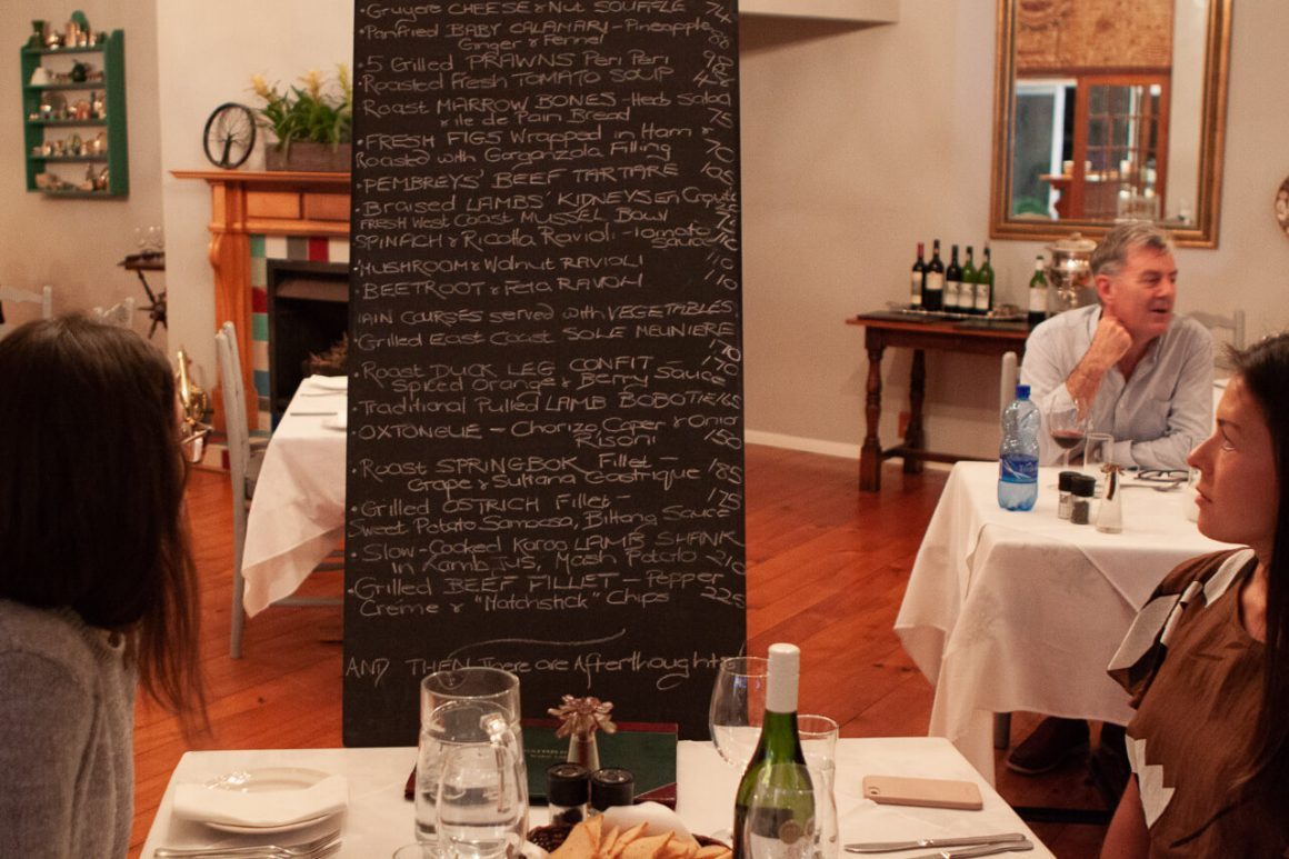 Rebecca and Chris looking at the menu board that was brought to our table at Pembrey's Restaurant in Knysna.