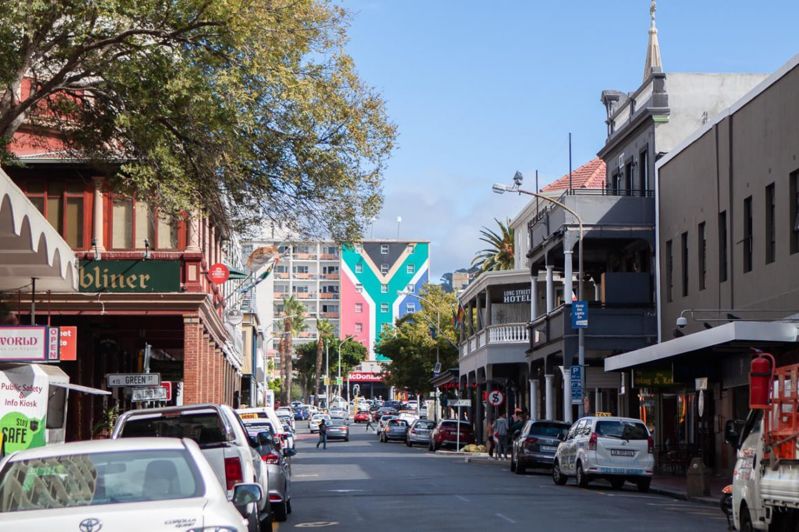 Looking down Long Street in Cape Town's CBD toward a building painted with the South African flag.