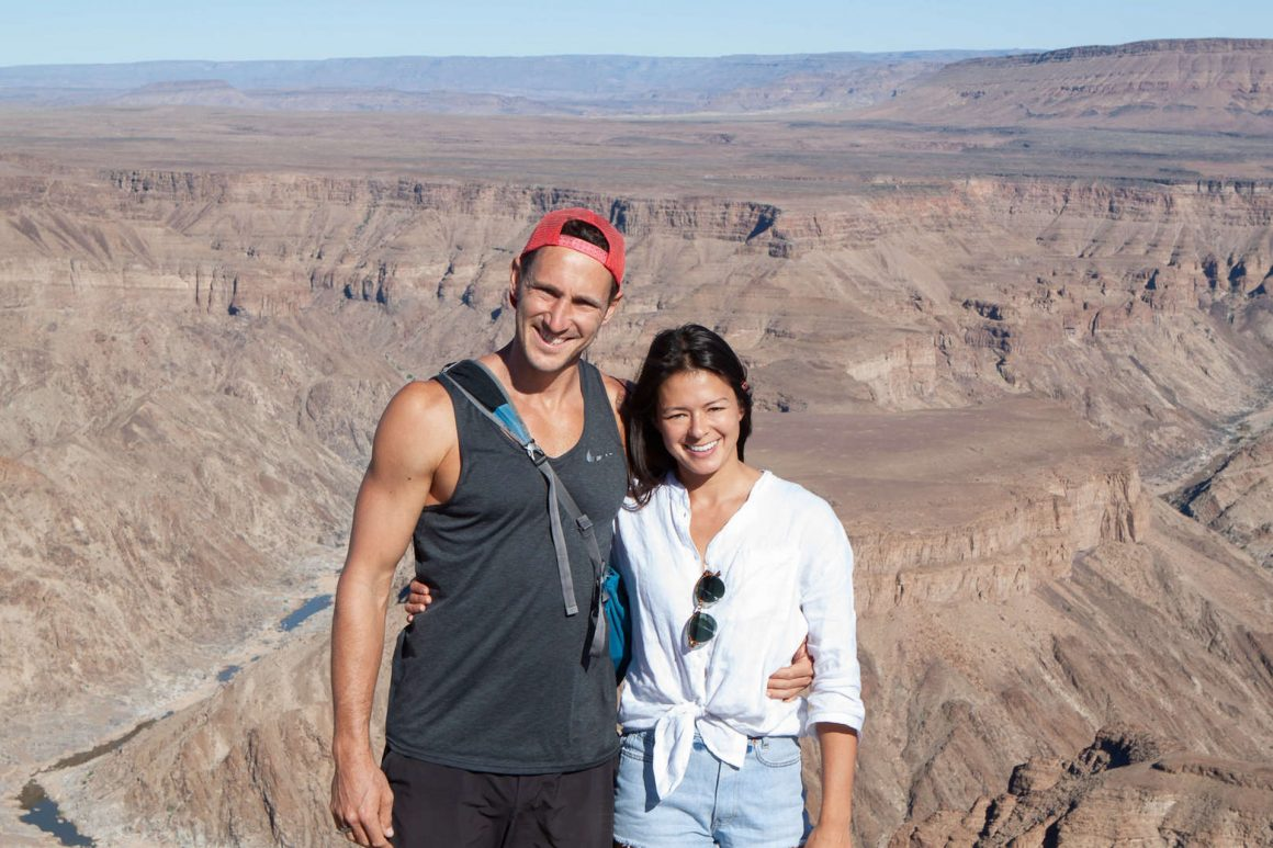 Chris and Kim with views of Fish River Canyon in Namibia, in the background.
