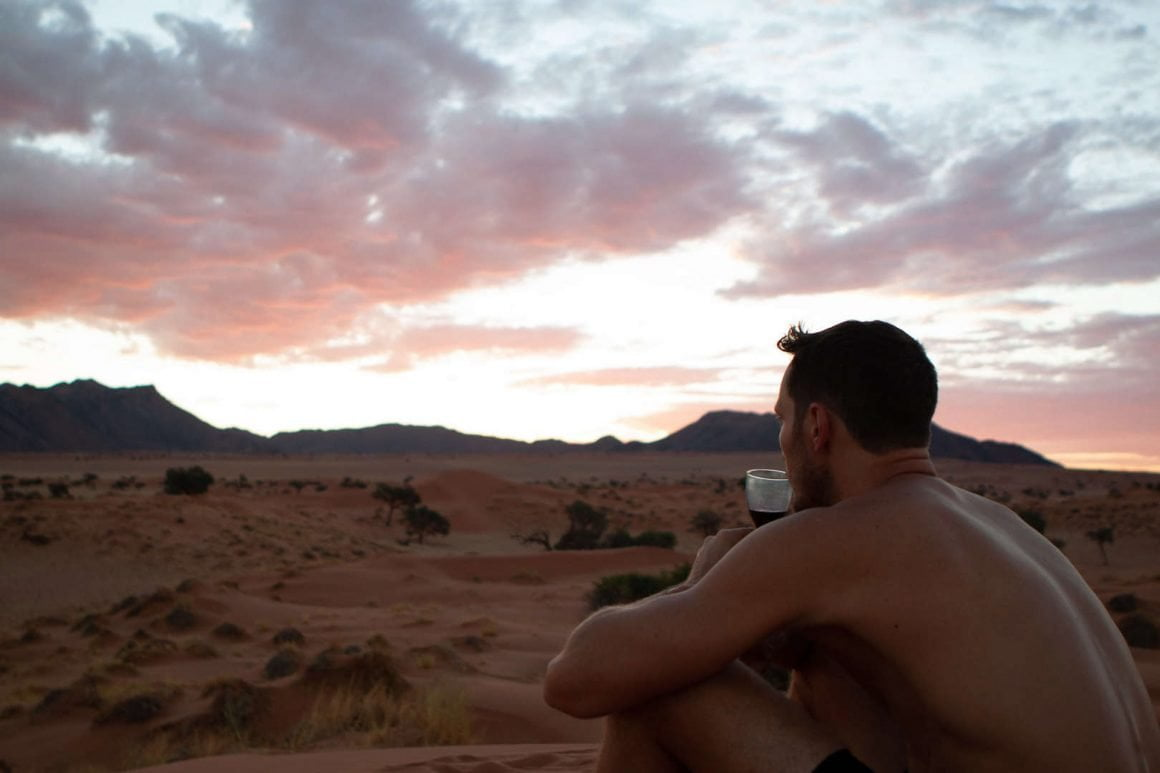 Chris sipping wine and enjoying the sunset on our private dune in Namibrand.
